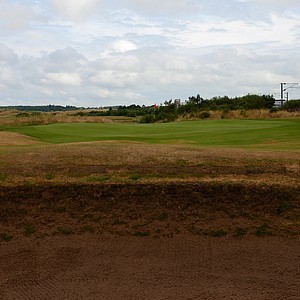 Most of the holes at Prestwick are heavily bunkered, but because the first is relatively short it is well bunkered as you can see from this massive crater fronting the first green.  Notice the train track just continues along the hole.
