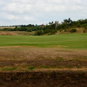 The green at the first hole is well bunkered in front.