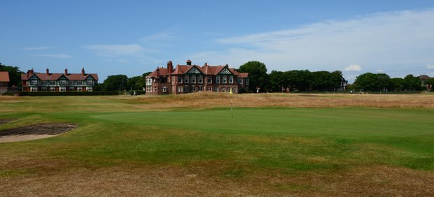 A look back from Royal Lytham's first hole to the clubhouse on the right and the Dormy House on the left.