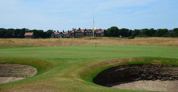 The green at Prestwick's fourth hole with the stately clubhouse in the background.