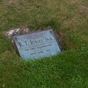 A plaque honoring Bobby Jones for his shot out of fairway bunkers to win the Open Championship at Royal Lytham.