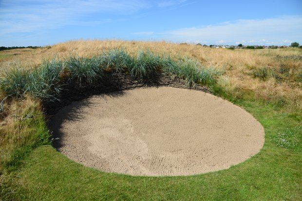 A look at one of the nastier bunkers at Royal Lytham.  Not all are as difficult as this, but with more than  200 bunkers on the course, it's not a picnic.