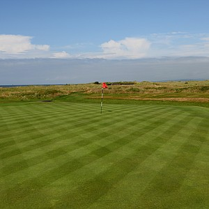The 13th green at Western Gailes, looking back toward the tee.