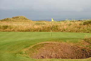 The first hole, called Station, features a green protected by a lone bunker at the left front.