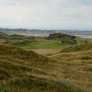 Since the hole is relatively short for a par 5, the second shot at Western Gailes' 6th hole is crucial.  The view to the green can be a little daunting, but tucked back behind the aiming post to the left is the green.