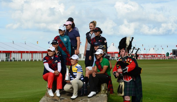 Players take time for a group photo at Swilcan Bridge during practice for the 2013 Women's British Open at St. Andrews.