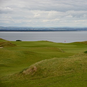Pier. The sixth hole is a downhill par 4 that dosen't come close to playing to its yardage of 421 yards from the back tees. The hole goes down to the water and has some dramatic views from the green.