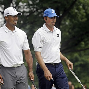 Tiger Woods and Matt Kuchar during a practice round for the 2013 WGC-Bridgestone Invitational at Firestone CC in Akron, Ohio.