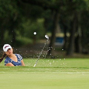 Brittany Mai hits out of the bunker at No. 9 during a practice round prior to the 2013 U. S. Women's Amateur at Country Club of Charleston.