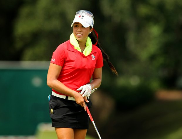 Christine Wong keeps cool with a Frog Togg's Chilly Pad during a practice round prior to the 2013 U. S. Women's Amateur at Country Club of Charleston.