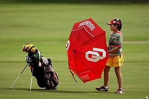 Lucy Li, is the youngest player in the championship field, at 10 years old, she makes her way around during a practice round prior to the 2013 U. S. Women's Amateur at Country Club of Charleston. Li is the youngest competitor in championship history.