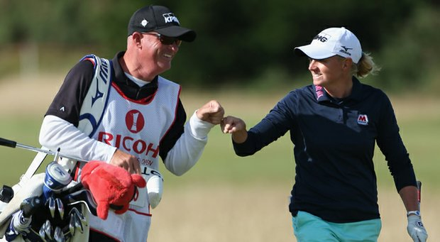 Stacy Lewis celebrates with caddie Travis Wilson on the 17th hole during the final round of the Ricoh Women's British Open at the Old Course in St Andrews.