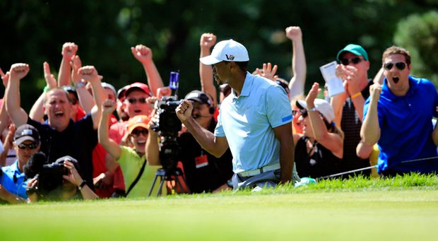 The crowd reacts with Tiger Woods after chipping in for birdie on the 13th green during the third round of the WGC-Bridgestone Invitational.