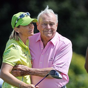 Annika Sorenstam and Arnold Palmer share a moment at the 2013 3M Championship.