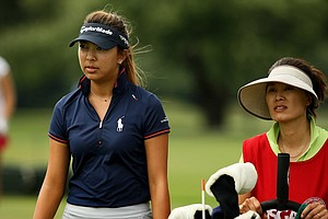 Alison Lee with her mom/caddie Sung Kim during the first round of stroke play at the 2013 U. S. Women's Amateur at Country Club of Charleston.