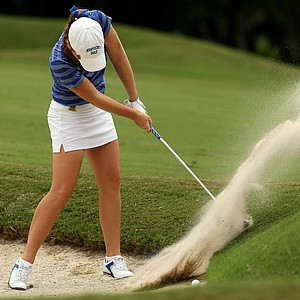 Liz Breed hits a bunker shot right next to Yu Liu's ball at No. 1 during the first round of stroke play at the 2013 U. S. Women's Amateur at Country Club of Charleston.
