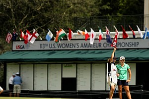 Kelli Murphy with her caddie at No. 18 during the first round of stroke play at the 2013 U. S. Women's Amateur at Country Club of Charleston.