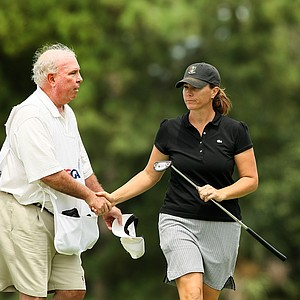 Meghan Stasi shakes hands with her caddie/father, Mike Bolger at No. 9 during the first round of stroke play at the 2013 U. S. Women's Amateur at Country Club of Charleston.