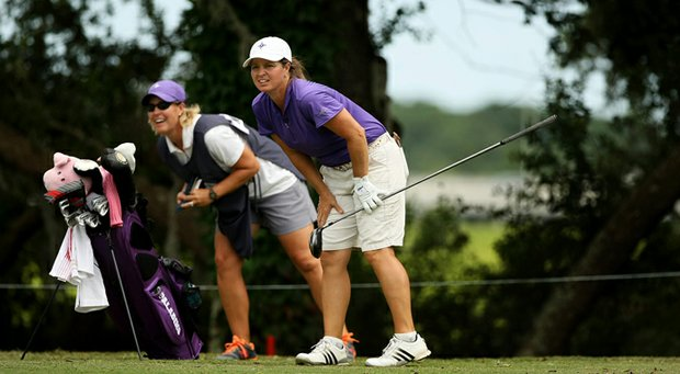 Dawn Woodard, right, watches a shot on Monday with caddie and friend Kelley Hester.