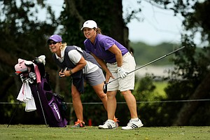 Dawn Woodard with her caddie Kelley Hester follow her tee shot at No. 10 during the first round of stroke play at the 2013 U. S. Women's Amateur at Country Club of Charleston.