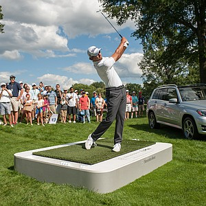 Adam Scott hits a shot at the Mercedes-Benz Hole-In-One Challenge during the 95th PGA Championship at Oak Hill Country Club.