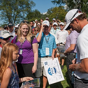 Adam Scott signs autographs at the Mercedes-Benz Hole-In-One challenge during the 95th PGA Championship at Oak Hill Country Club.
