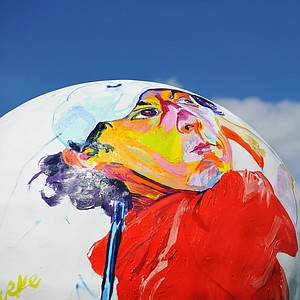 A painting of Rory McIlroy is pictured on a giant golf ball during a practice round prior to the start of the 95th PGA Championship at Oak Hill Country Club.