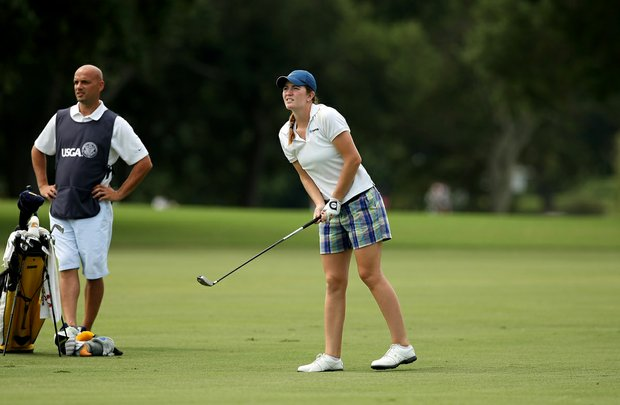 Jordan Britt with her caddie Wes Moore at No. 9 during the second round of stroke play at the 2013 U. S. Women's Amateur at Country Club of Charleston.