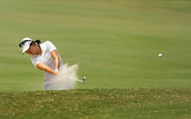 Yueer Cindy Feng hits out of a fairway bunker at No. 9 during the second round of stroke play at the 2013 U. S. Women's Amateur at Country Club of Charleston.