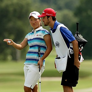 Yumi Matsubara consults with her caddie Andrew Shaw at No. 9 during the second round of stroke play at the 2013 U. S. Women's Amateur.
