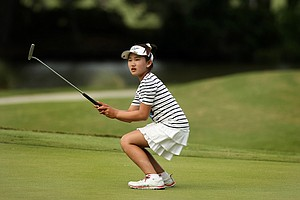Lucy Li, 10, narrowly misses a birdie putt at No. 8 during the second round of stroke play at the 2013 U. S. Women's Amateur at Country Club of Charleston.