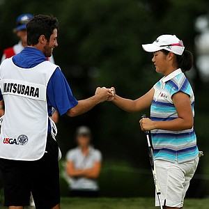 Yumi Matsubara fist bumps her caddie Andrew Shaw after posting a 64, setting a low score record for this championship, during the second round of stroke play at the 2013 U. S. Women's Amateur.