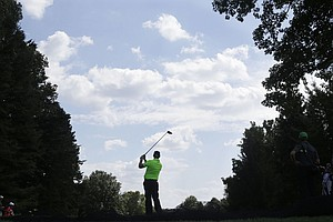 Hunter Mahan hits a tee shot on the 16th hole during a practice round for the PGA Championship at Oak Hill Country Club.