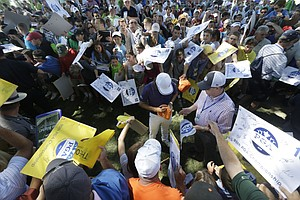 Rickie Fowler signs autographs near the 18th green during a practice round for the PGA Championship at Oak Hill Country Club.