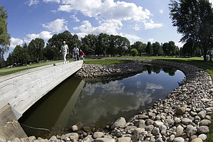 Steve Stricker walks over a bridge on the 16th hole during a practice round for the PGA Championship at Oak Hill Country Club.