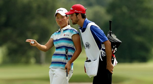 Yumi Matsubara and caddie Andrew Shaw look at a putt Tuesday afternoon at the U.S. Women's Amateur.