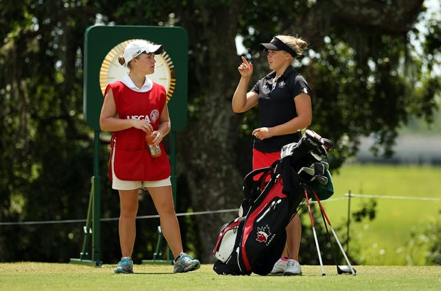 Brooke Mackenzie Henderson with her caddie at No. 10 during the Round of 64 match play at the 2013 U. S. Women's Amateur. Mackenzie lost to Kacie Komoto 4 and 3.