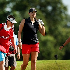 Emily Tubert, center, defeated Ashlan Ramsey, right, 2 and 1 during the Round of 64 match play at the 2013 U. S. Women's Amateur.