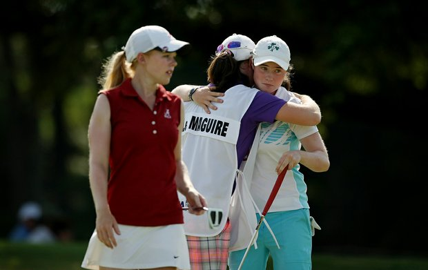 Leona Maguire and her twin sister, Lisa, celebrate Leona's win over Stephanie Meadow, 3 and 2, during the Round of 64 match play at the 2013 U. S. Women's Amateur.
