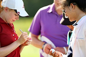 Despite having lost her match, Stephanie Meadow, stayed to watch teammate Emma Talley's match and sign autographs, during the Round of 64 match play at the 2013 U. S. Women's Amateur.