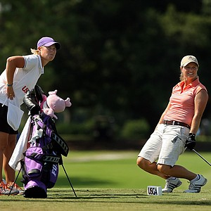 Dawn Woodard and her caddie Kelley Hester, along with opponent, Alison Lee watch Woodard's ball at No. 17 during the Round of 64 match play at the 2013 U. S. Women's Amateur.