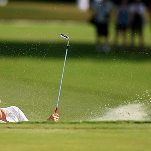 Alexandra Harkins blasts out of a bunker at No. 16 during the Round of 64 match play at the 2013 U. S. Women's Amateur.