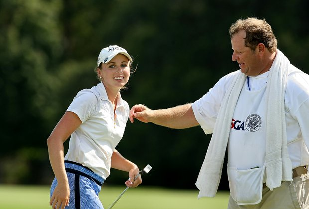 Alexandra Harkins with her caddie Steve Griner defeated Princess Superal during the Round of 64 match play at the 2013 U. S. Women's Amateur.