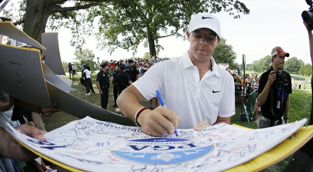 Rory McIlroy signs autographs after a practice round for the PGA Championship at Oak Hill Country Club.