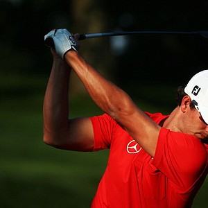 Adam Scott hits a shot during a practice round prior to the start of the 95th PGA Championship at Oak Hill Country Club in Rochester, N.Y.