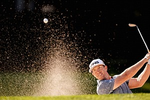 Hunter Mahan players a bunker shot during a practice round at Oak Hill Country Club.