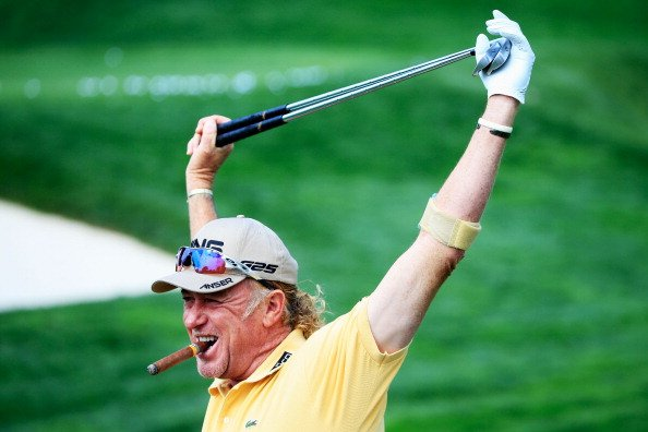 Miguel Angel Jimenez waits on the practice ground at Oak Hill Country Club in Rochester, N.Y.