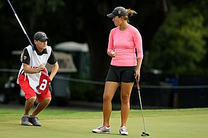 Annie Park consults with her caddie and USC assistant coach, Justin Silverstein, at No. 9 during the Round of 32 match play at the 2013 U. S. Women's Amateur at Country Club of Charleston. Park defeated Brittany Fan, 2 and 1.