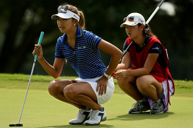 Alison Lee with her caddie Andrea Lee during the Round of 32 match play at the 2013 U. S. Women's Amateur at Country Club of Charleston.