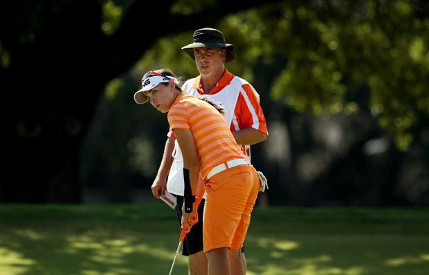Casie Cathrea lines up a putt at No. 16 with her dad/caddie Harry, during the Round of 16 match play at the 2013 U. S. Women's Amateur.